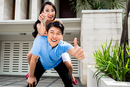 Chinese woman and man enjoying the new home