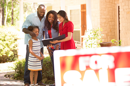 Realtor and family looking at new home to purchase.